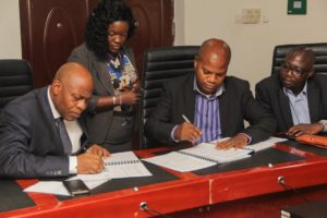 Dr Oluwafemi Babalola (L) and Mr Lateef Kaffo (R) Directors of 1XBET signing the Terms and Conditions